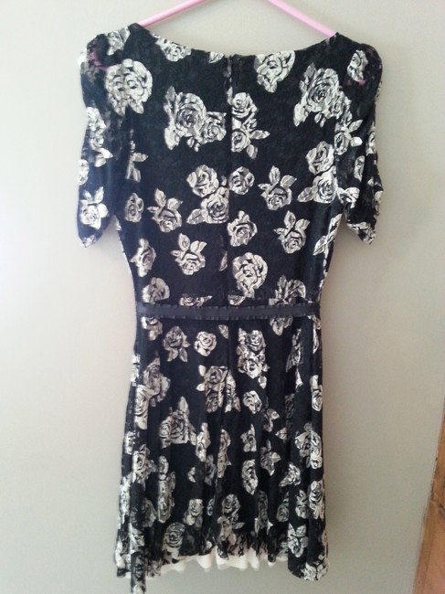 American Rag short dress Black with off white flowers on Tradesy