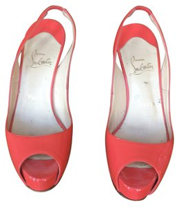 Christian Louboutin Coral not pink Pumps