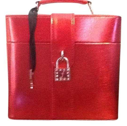 Preload https://img-static.tradesy.com/item/1720485/frederick-s-of-hollywood-metalic-red-fredericksburg-chest-with-padlock-and-two-keys-0-0-540-540.jpg