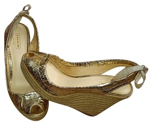 Coach Gold Snakeskin Wedges