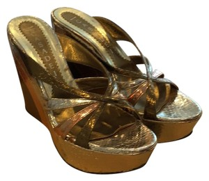 Casadei Gold, Rose Gold, Silver, and Bronze. Wedges