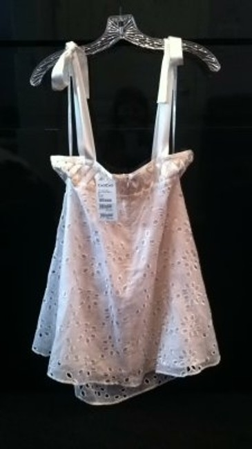 Preload https://item5.tradesy.com/images/bebe-white-eyelet-tank-topcami-size-2-xs-172284-0-0.jpg?width=400&height=650