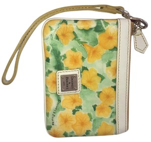 Dooney & Bourke Wristlet in White/yellow/green. Interior - Red