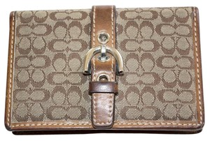 Coach Coach Jacquard Beige & Brown Signature Pattern Bi-fold Card Wallet with leather trim and soho buckle.