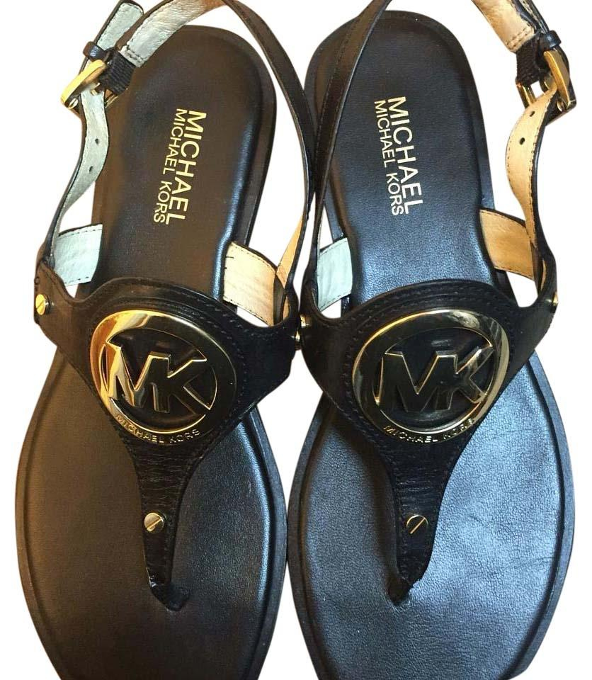 841fb71a77e MICHAEL Michael Kors Black leather with gold logo Sandals Image 0 ...
