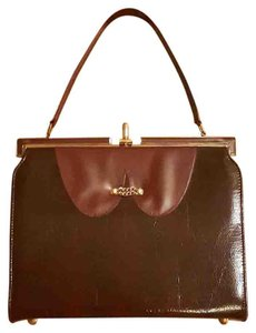 A Naturalize Handbag Satchel in Burgundy