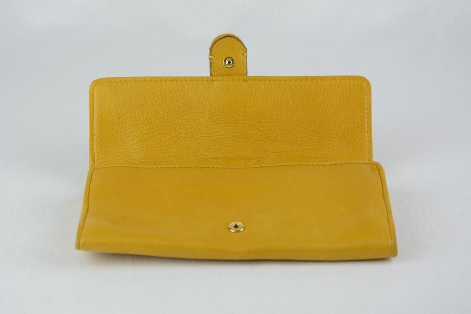 3db4058634b2 Michael Kors Carry All Montauk Wallet Yellow Leather & Canvas Clutch ...