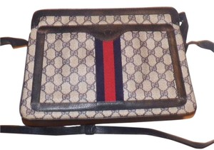 Gucci Gold Hardware Red/navy Large G Logo Accordion Boottom Two Strap Lengths Satchel in shades of blue with red & navy stripe accents
