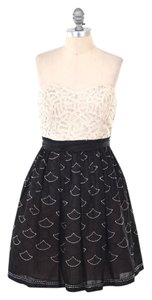Anthropologie short dress Beige & Black Embroidered Lace Strapless on Tradesy