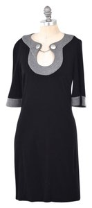 Trina Turk short dress Black Chain Neck Bell Sleeve on Tradesy