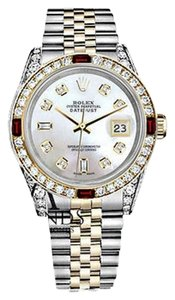 Rolex Women's Rolex S/S & Gold 31mm Datejust Watch White MOP Dial Ruby & Diamond bezel