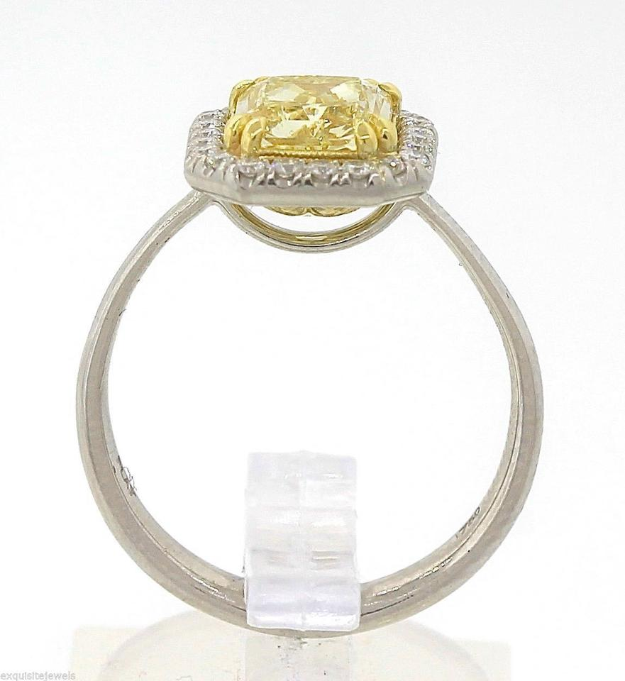 ring oval with pear diamonds and accented diamond side rings engagement yellow pin shaped fancy canary platinum
