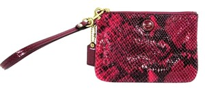 Coach Zip Close Snakeskin Wristlet in Purple