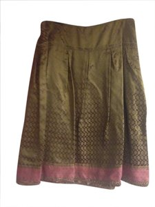 Cynthia Steffe Skirt olive green background, pink oval shaped designs.