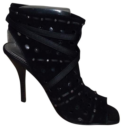 Preload https://item1.tradesy.com/images/fergie-black-magnetized-bootsbooties-size-us-6-regular-m-b-1732865-0-0.jpg?width=440&height=440