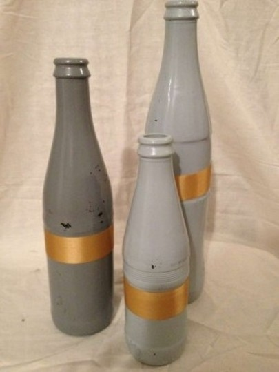 Preload https://item2.tradesy.com/images/gray-mixed-shape-painted-glass-bottles-reception-decoration-173396-0-0.jpg?width=440&height=440
