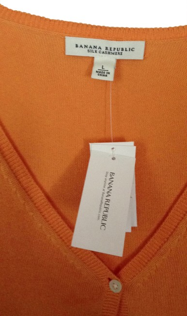 Preload https://item3.tradesy.com/images/banana-republic-apricot-sweaterpullover-size-12-l-173657-0-0.jpg?width=400&height=650