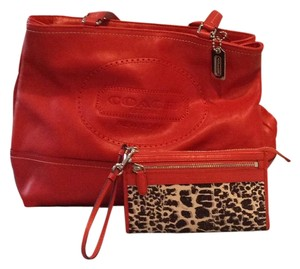 Coach Tote in Burnt orange, wristlet is same color with cheeta print