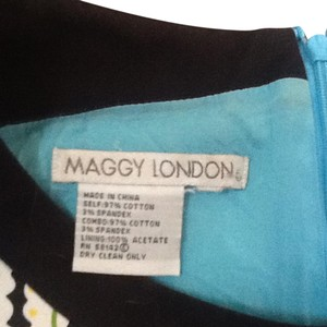 Maggy London short dress Blue and yellow/black and green on Tradesy