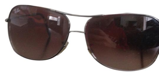 Preload https://item1.tradesy.com/images/ray-ban-gunmetal-frame-brown-lens-sunglasses-1738185-0-0.jpg?width=440&height=440