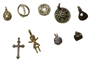 Nine necklace charms.