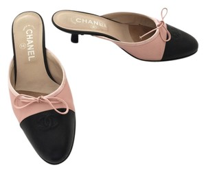 Chanel pink with black cap toe Mules