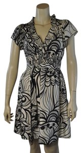 BCBGMAXAZRIA short dress Black & Ivory Cream Print Silk on Tradesy