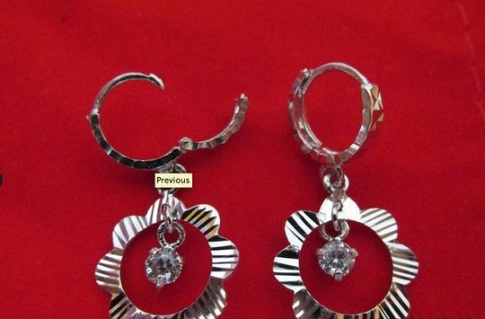 Other Sterling Silver Diamond Cut Earring with Cubic Zirconia