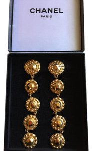 Chanel Long Chanel gold medallion dangle earrings