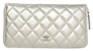 Chanel Chanel Silver Quilted Lambskin Leather Zippy Wallet SHW