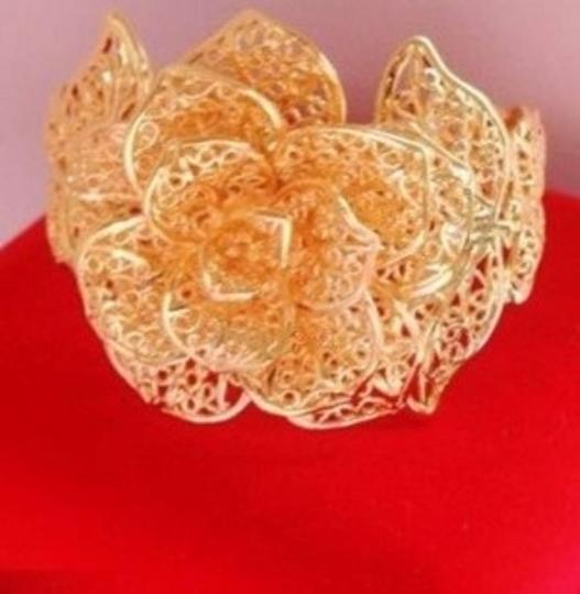 Preload https://item3.tradesy.com/images/gold-fashionable-rose-traditional-chinese-and-indian-plated-bangles-dragon-and-phoenix-bangles-brace-174597-0-0.jpg?width=440&height=440