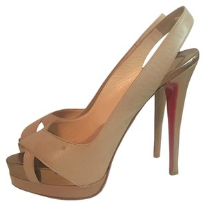 Christian Louboutin Beige and gold Platforms