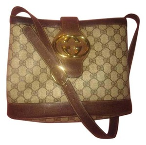 Gucci Extra Large Size Satchel in shades of brown coated canvas/leather & bold gold GG snap