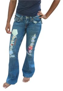 True Religion Stressed Denim Patchwork Denim Boot Cut Jeans