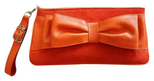 Preload https://item2.tradesy.com/images/isabella-fiore-bow-tie-orange-suede-and-leather-clutch-1750081-0-0.jpg?width=440&height=440