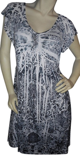 Preload https://item1.tradesy.com/images/unity-world-wear-batik-blues-print-with-embleshments-knee-length-short-casual-dress-size-petite-14-l-17530390-0-1.jpg?width=400&height=650