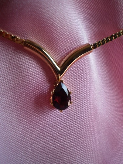 Preload https://item3.tradesy.com/images/new-garnet-solitaire-necklace-175342-0-0.jpg?width=440&height=440