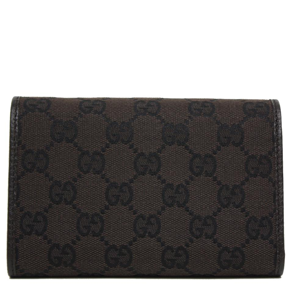 ec1d4d79009 Gucci Gucci GG Canvas and Leather Women s Trifold Wallet 263114 Image 8.  123456789