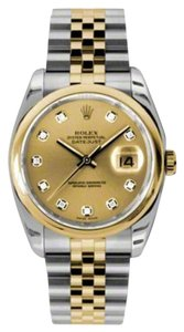 Rolex Rolex New Style Pre Owned Datejust Steel and Yellow Gold Custom Champagne Diamond Dial 36mm.