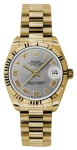 Rolex Rolex New Style Pre Owned Datejust Yellow Gold Grey Roman Dial 31mm.