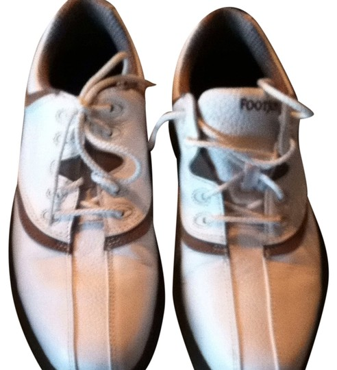 Preload https://item1.tradesy.com/images/footjoy-white-with-brown-trim-golf-sneakers-size-us-65-regular-m-b-1757925-0-0.jpg?width=440&height=440