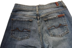 Preload https://item5.tradesy.com/images/7-for-all-mankind-distressed-blue-boot-cut-jeans-size-26-2-xs-1758614-0-2.jpg?width=400&height=650