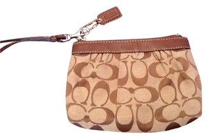 Coach Wristlet in Brown With Tan Trim
