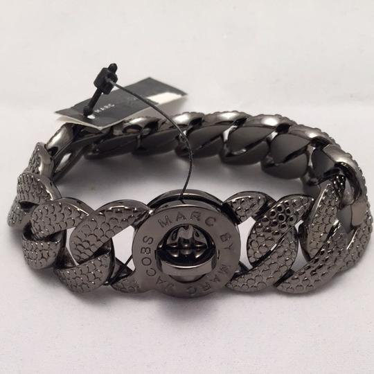 Preload https://item5.tradesy.com/images/marc-by-marc-jacobs-hematite-lizard-textured-metal-katie-turnlock-bracelet-1760349-0-0.jpg?width=440&height=440