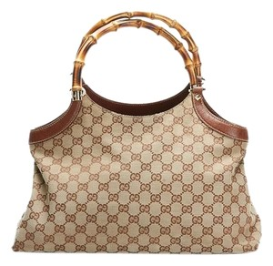 Gucci Monogram Canvas Leather Tote in Brown
