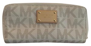 Michael Kors Gold Michael Kors tag on the front