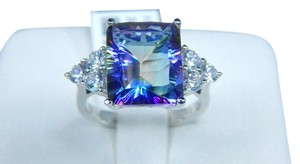 Mystic Sterling Silver. Gorgeous Emerald cut Mystic quartz Ring Main stone Surrounded by Two Sets of Three Cubic Zirconia Princess Cuts accents in Three-Stone Setting