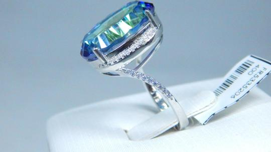 Mystic Sterling Silver. Dazzling Oval shape 18x13mm Starburst cut Mystic blue quartz Ring in Classical Tension Setting Image 1