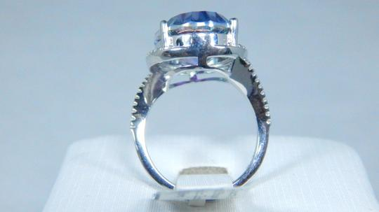 Mystic Sterling Silver. Dazzling Oval shape 18x13mm Starburst cut Mystic blue quartz Ring in Classical Tension Setting Image 2
