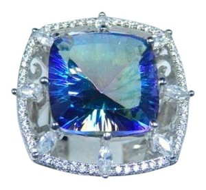Mystic Sterling Silver. Stunning Cushion shape Mystic blue quartz Ring Surrounded by a single Row of Cubic Zirconia and 8 larger CZ's Stone intercepting the rows at different points in Bezel Setting